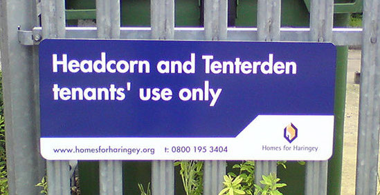 Information Sign mounted to tri point fence for Homes for Haringey.