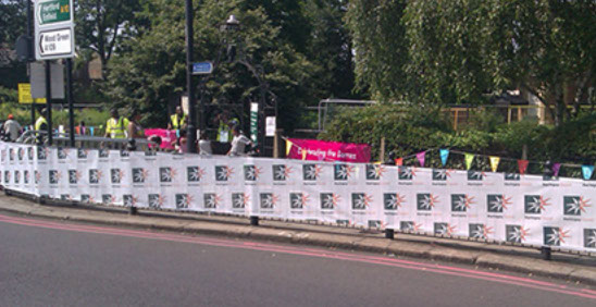 Printed mesh banner to celebrate the Olympic torch passing through Haringey