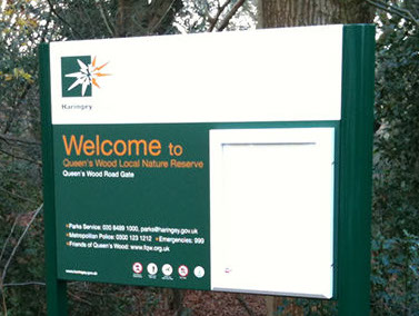 Information sign with lockable poster case.