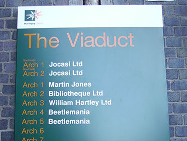 Wall mounted aluminium industrial estate sign.
