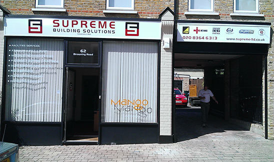 Main fascia and window graphics for Supreme Building Solutions.